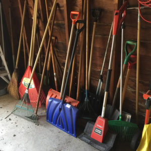 Show shovels stored in a garage, so they are cold.