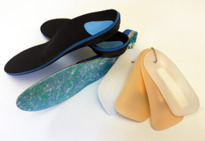 Different styles of custom orthotic shoe inserts