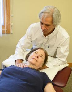 Bill treats a PT client for headaches.