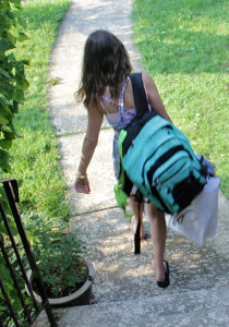 improperly worn backpack